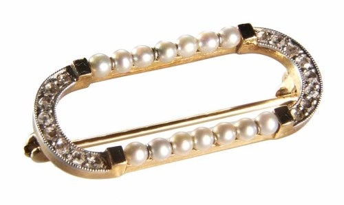 Lot 232-Cartier Art Deco diamond, seed pearl and black onyx brooch