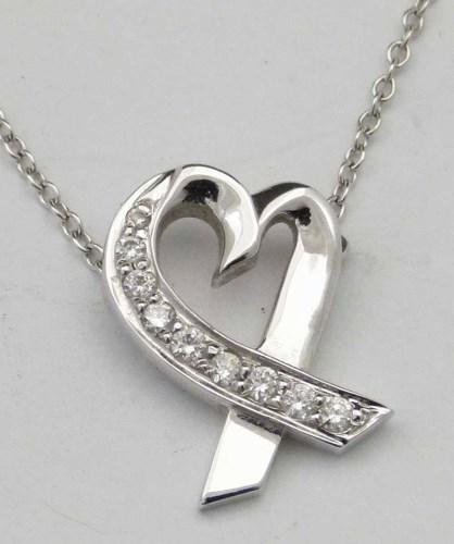 Lot 337-Tiffany 750 and diamond pendant on chain