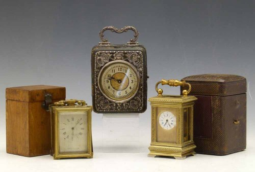 Lot 642-Miniature brass carraige clock and two others