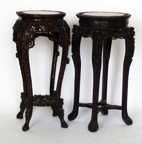 Lot 687-Two Chinese hardwood jardinière stands