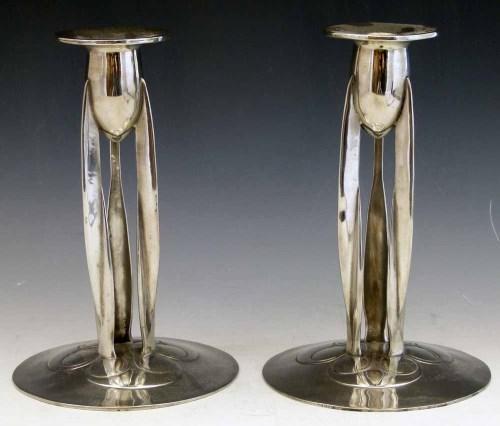 Lot 10-Pair of Archibald Knox candlesticks