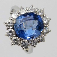 Lot 433-Sapphire and diamond oval cluster ring