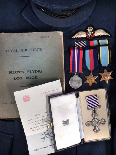 Lot 31-A fine Second World War Bomber Command operations D.F.C. group of four awarded to 1076882 Flight Lieutenant Lewis H. Hemming, together with Log Book.