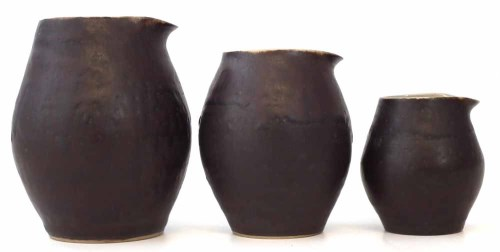 213 - Three Lucie Rie jugs.