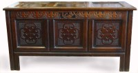 650 - Oak coffer, late 17th century, the panelled top