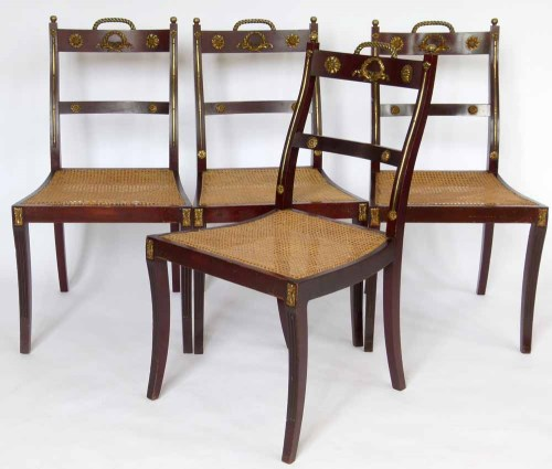 Lot 475-Set of four Collinson & Lock brass chairs.
