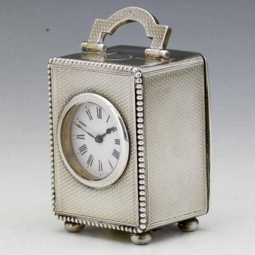 Lot 246-Asprey silver carriage clock