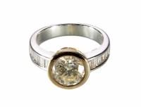 Lot 259-2.17 carat diamond solitaire ring with diamond set shoulders