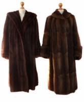Lot 405-Two calf length brown fur coats