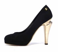 Lot 428 - Chanel black suede shoes with gold heels.