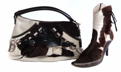 Lot 453 - Christian Dior cowhide bag and matching boots