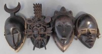 52 - Two Yaure masks, a Senufo mask and a Dan mask,
