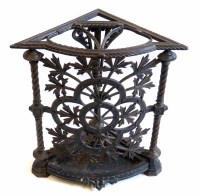 463 - Late Victorian Arts & Crafts design cast iron corner walking cane stand,