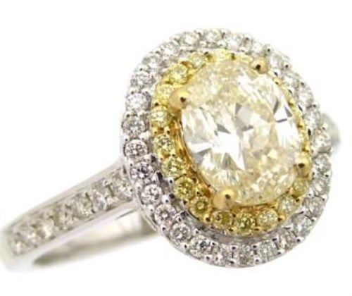 Lot 321-Fancy yellow diamond oval cluster ring