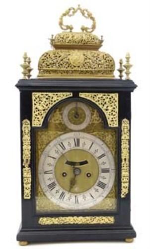 Lot 671-Ebony veneered bracket clock.