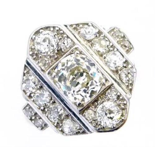 Lot 284-Art deco platinum and diamond ring