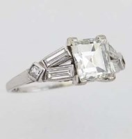 Lot 282-Platinum and diamond ring, the step-cut central