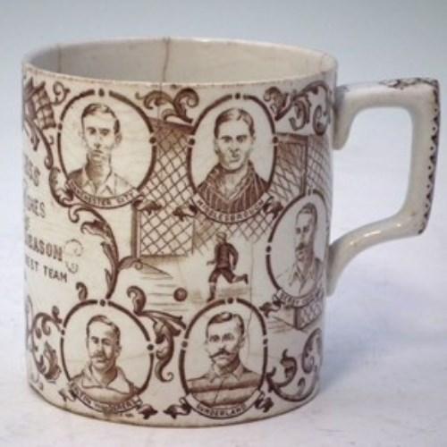 Lot 122-Football mug.