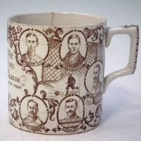 Lot 122 - Football mug.