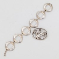 179 - Georg Jensen brooch and a bracelet.