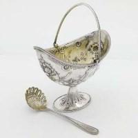 Lot 261 - Victorian silver sugar basket and sugar sifter.