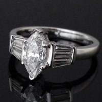 Lot 316-Colourless (D) marquise diamond ring, 1.05ct, on
