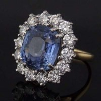 Lot 453-Ceylon sapphire cluster ring, 9.76ct, surrounded
