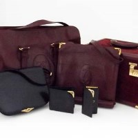 527 - Collection of Cartier hand luggage and bags: