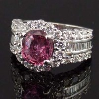 Lot 424-Natural pink sapphire and diamond cluster ring