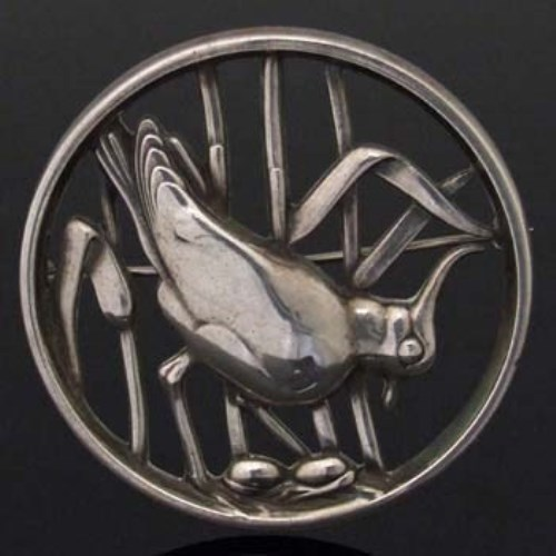 Lot 358-Georg Jensen silver circular brooch of a crested