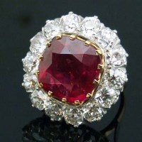 Lot 389-Burmese ruby and diamond cluster ring