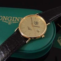 368 - Longines man's wristwatch, gilt dial with baton