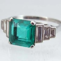 Lot 286-Emerald and diamond ring, in Cartier box