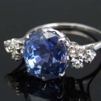Lot 295-White gold sapphire and diamond cluster ring.