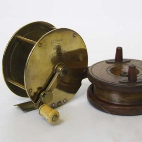 404 - Farlows brass reel and one other wooden reel.