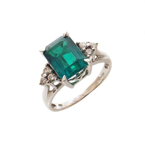Lot 60-Emerald single stone 18ct white gold ring with diamond set shoulders