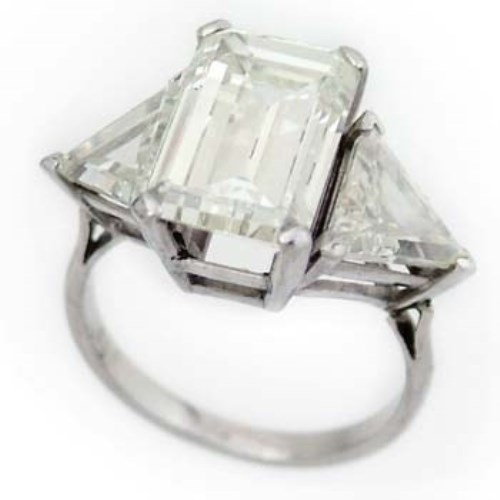 Lot 464-Emerald cut diamond ring with triangular shoulders