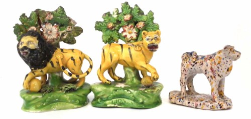 Lot 202-Pair of Staffordshire pearlware Walton type lions