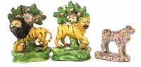 202 - Pair of Staffordshire pearlware Walton type lions