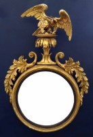 607 - A Regency convex wall mirror