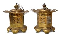 150 - A pair of 20th century Chinese pressed brass pagoda lanterns