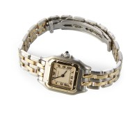 244 - A lady's Cartier Santos steel and yellow gold bracelet watch
