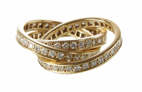 Lot 292-Cartier 18ct gold diamond inter-locking 3 section ring