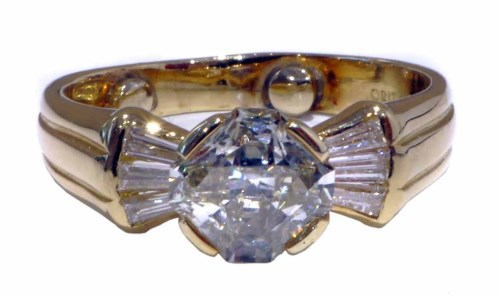 Lot 216-18ct yellow gold diamond ring, the fancy cut central diamond weighing approx. 1.79ct, tapered baguette diamond shoulders, approx. 0.60ct total, gross