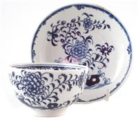 Lot 144-Lowestoft tea-bowl and saucer painted with a rare under-glaze blue pattern c.1775.