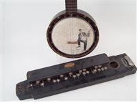Lot 23-J.E. Dallas banjo and a C.M.H. Indian banjo