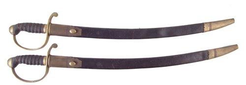 Lot 42-Pair of constabulary short swords.