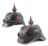 38 - Two Pickelhaube helmets.