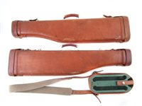 32 - Two leg of mutton gun cases and a cartridge case
