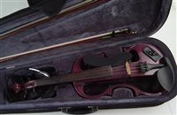Lot 9-Carlo Giordano electric violin with case and one other case.